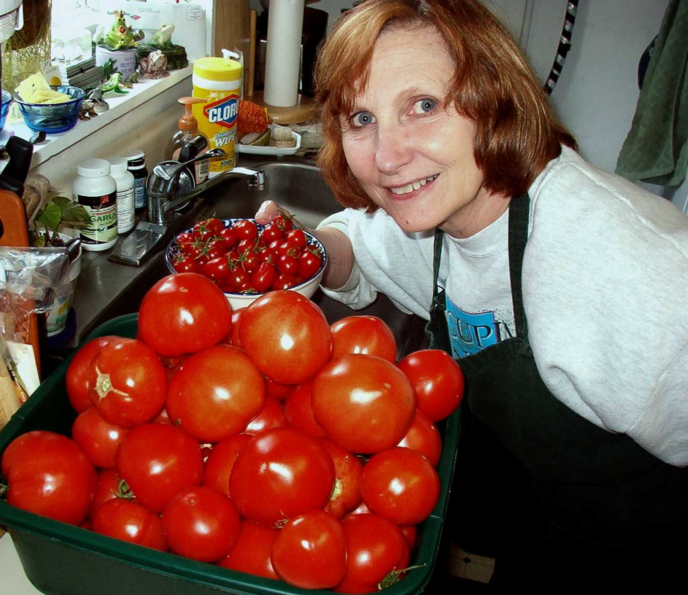 Linda with fresh tomatoes